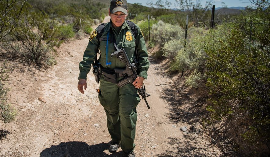 In this Aug. 30, 2016 photo, Lorena Apodaca patrols the area along the fence that makes up the U.S-Mexico border near the boot heel area in southern New Mexico. (Roberto E. Rosales/The Albuquerque Journal via AP)
