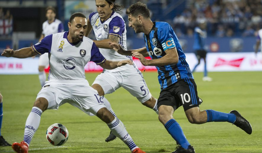Montreal Impact midfielder Ignacio Piatti, right, battles Orlando City FC defender Kevin Alston, left, and midfielder Servando Carrasco for the ball during the first half of an MLS soccer game Wednesday, Sept. 7, 2016 in Montreal. (Paul Chiasson/The Canadian Press via AP)