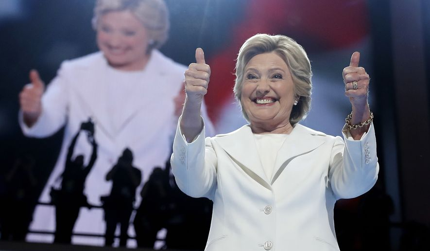 Hillary Clinton gestures to the crowd during the final day of the Democratic National Convention on July 28 in Philadelphia. (Associated Press)
