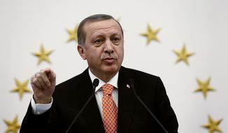 Turkish President Recep Tayyip Erdogan addresses a meeting with governors in Ankara, Turkey, Thursday, Sept. 8, 2016, Turkey's education ministry says 11,285 of its personnel have been suspended amid suspicions they may be linked to Turkey's outlawed Kurdish rebels. (Yasin Bulbul, Presidential Press Service, Pool photo via AP)