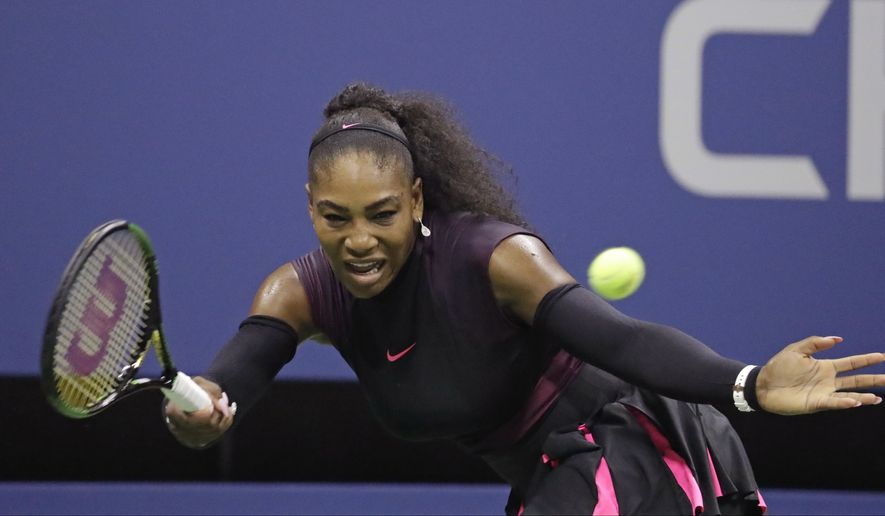 Serena Williams returns a shot to Karolina Pliskova, of the Czech Republic, during the semifinals of the U.S. Open tennis tournament, Thursday, Sept. 8, 2016, in New York. (AP Photo/Julio Cortez)