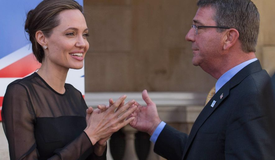 UN Special Envoy Angelina Jolie Pitt, left, speaks to US Defence Secretary Ash Carter, as she attends a UN Peacekeeping Defence Ministerial meeting, in London, Thursday Sept.  8, 2016. (Stefan Rousseau/PA via AP)