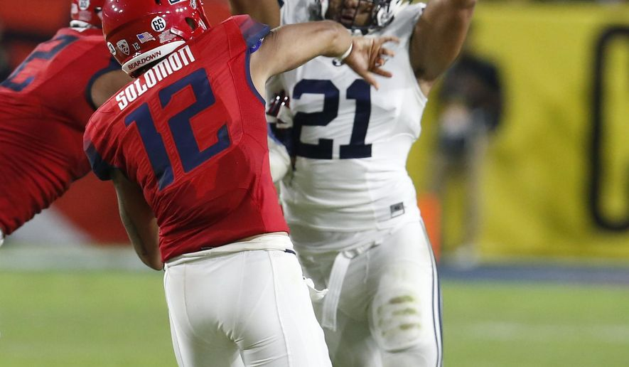 FILE - In this Saturday, Sept. 3, 2016, file photo, BYU linebacker Harvey Langi (21) pressures Arizona quarterback Anu Solomon (12) during an NCAA college football game in Phoenix. BYU and Utah may have as much crossover within the two programs as any two major football schools in the country. Langi began his collegiate career at Utah. (AP Photo/Rick Scuteri, File)