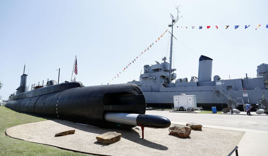 In this Thursday, Sept. 1, 2016 photo, the submarine USS Cavalla is displayed with the destroyer USS Stewart in the background at Seawolf Park, in Galveston, Texas. Several years ago, the submarine and destroyer were in such bad shape, that the Navy wanted them removed from Seawolf Park. The hiring of two Navy veterans and a lot of work by volunteers has transformed them into living museums of World War II combat vessels. (Karen Warren/Houston Chronicle via AP)