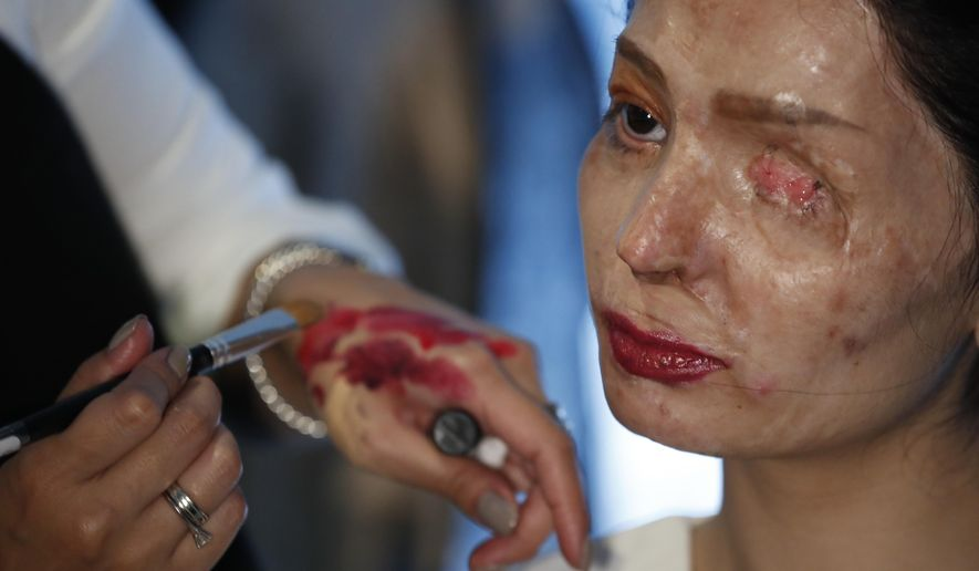 Model and acid attack victim Reshma Querishi has her make up and hair done before walking the runway for the Archana Kochhar collection during Fashion Week in New York, Thursday, Sept. 8, 2016. (AP Photo/Mary Altaffer)