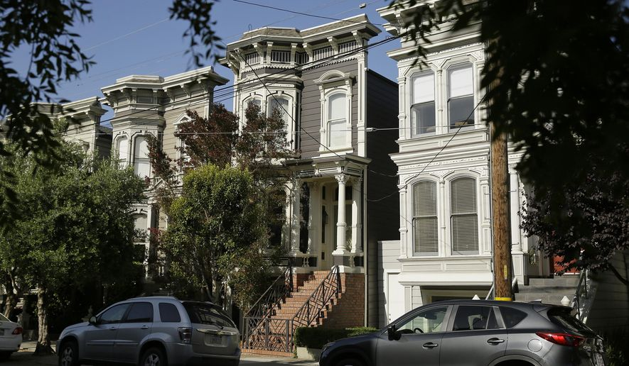 """FILE - This May 27, 2016 file photo shows a Victorian home, center, made famous by the television show """"Full House."""" The home is now available to rent for $13,950 a month. The 1883 villa was put on the market in May with a $4.15 million price tag, but it didn't sell. (AP Photo/Eric Risberg,File)"""