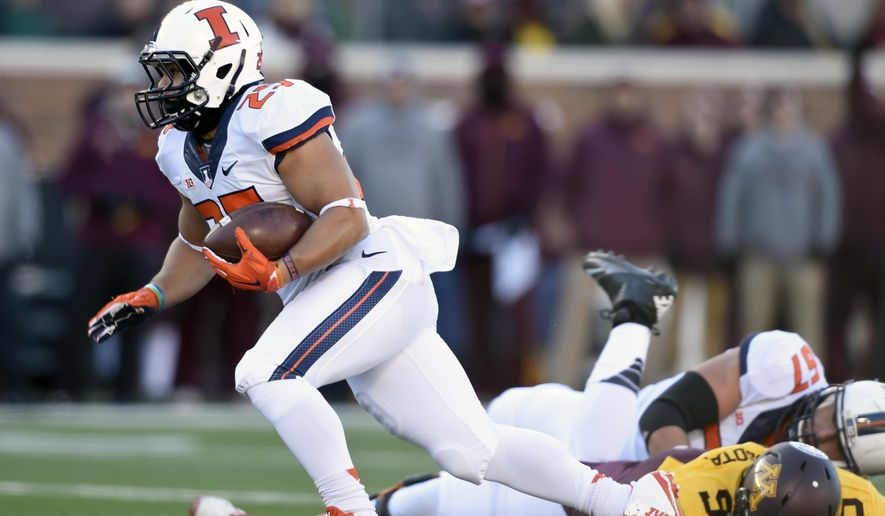 FILE - In this Nov. 21, 2015, file photo, Illinois' running back Kendrick Foster (25) carries the ball against Minnesota during an NCAA college football game in Minneapolis. As a high school player in Peoria, Ill., big games and big runs were normal for Foster. The 5-foot-9 Foster is now at Illinois, and he's the owner of a day like no other Illini running back has ever had. (AP Photo/Hannah Foslien File)