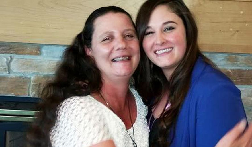 In this July 28, 2016 photo provided by Lanni Klasner, Rita Maze, left, and her daughter, Rochelle Maze, pose for a photo in Great Falls, Mont. Rita Maze was abducted in Montana on Sept. 6, 2016, and found dead in the trunk of her car, found abandoned near Spokane, Wash., International Airport early on Sept. 7. (Lanni Klasner via AP)