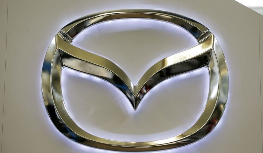 FILE - This Feb. 14, 2013, file photo, shows the Mazda logo on a sign at the 2013 Pittsburgh Auto Show, in Pittsburgh. Mazda recalled Thursday, Sept. 8, 2016, cars and SUVs worldwide because the rear hatches can fall on people and injure them. (AP Photo/Gene J. Puskar, File)
