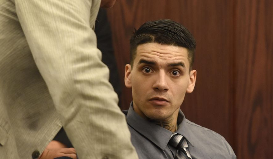 "Suspect Andrew Romero appears during the first day of testimony in his trial in Los Lunas, N.M., Thursday, Sept. 8, 2016. Romero is on trial for the shooting death of Rio Rancho Officer Gregg ""Nigel"" Benner, who shot and killed after making a traffic stop in an Albuquerque suburb. (Dean Hanson/The Albuquerque Journal via AP)"