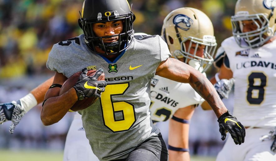 FILE - In this Sept. 3, 2016, file photo, Oregon wide receiver Charles Nelson (6) scores a touchdown during the third quarter against UC Davis during an NCAA college football game in Eugene, Ore. Nelson had 288 all-purpose yards for the No. 24 Ducks in the season opener as he transitions back from the defense to the offense. He chalked up a pair of fumbles to jitters. (AP Photo/Thomas Boyd, file)