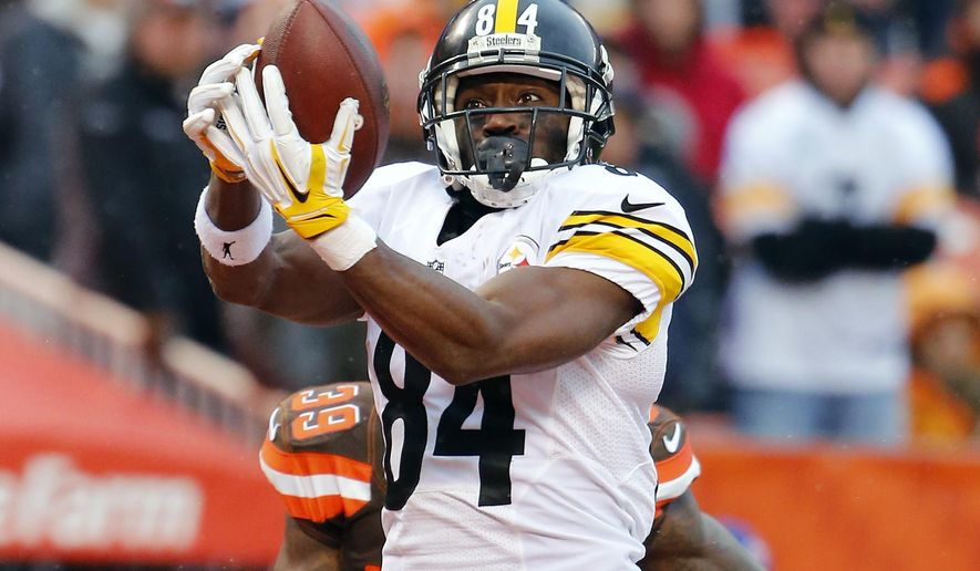FILE - In this Jan. 3, 2016, file photo, Pittsburgh Steelers wide receiver Antonio Brown catches a touchdown pass against the Cleveland Browns during an NFL football game in Cleveland, Ohio. After the customary season-opening flyover, keep your eyes in the air when the Steelers visit the Redskins. Ben Roethlisberger and Kirk Cousins will go pass for pass in the Monday night matchup at FedEx Field. (Winslow Townson/AP Images, File)