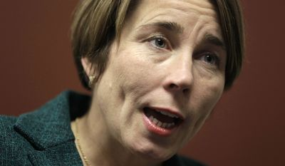 In this Monday, Dec. 15, 2014 photo, Massachusetts Attorney General-elect Maura Healey speaks during an interview with The Associated Press in Boston. Healey will become the nation's first openly gay state attorney general when she takes office in January. (AP Photo/Steven Senne)
