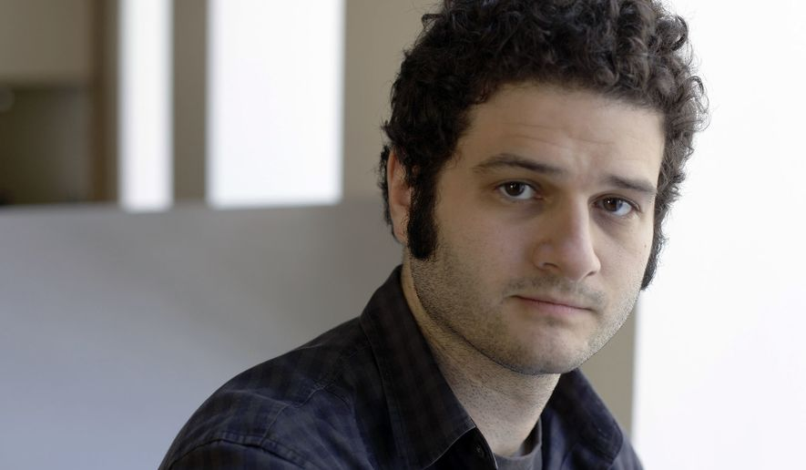 "Dustin Moskovitz, a Facebook co-founder, poses outside of his office in San Francisco in this April 26, 2012 file photo. Moskovitz says he is giving $20 million to help defeat Donald Trump, calling the Republican presidential candidate divisive and dangerous and his appeals to Americans who feel left behind ""quite possibly a deliberate con.""  (AP Photo/Eric Risberg) **FILE**"