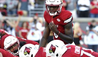 Louisville quarterback Lamar Jackson calls out at the line of scrimmage during the team's NCAA college football game against Charlotte in Louisville, Ky., in this Sept. 1, 2016 file photo. Jackson gets a Friday night spotlight game after accounting for eight touchdowns last week against Charlotte. Eight! In a season with lots of big stars, Jackson is a B-list Heisman contender for now. The next two weeks could get his name on the marquee. (AP Photo/Timothy D. Easley, File) **FILE**