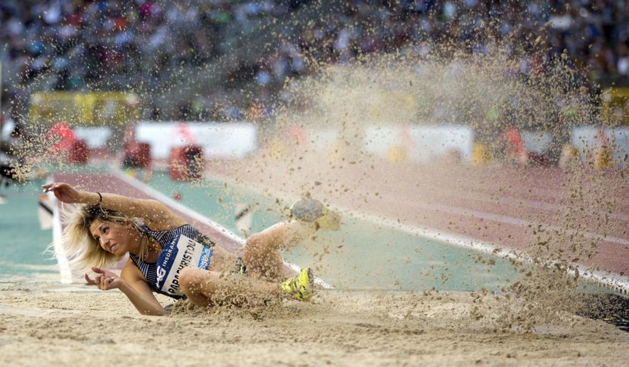 Paraskevi Papcristou of Greece competes during the women's triple jump at the Diamond League Memorial Van Damme athletics event, at the King Baudouin stadium in Brussels on Friday, Sept. 9, 2016. (AP Photo/Virginia Mayo)
