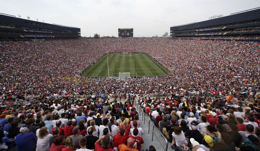 FILE - In this Aug. 2, 2014, file photo, Real Madrid plays Manchester United during a Guinness International Champions Cup soccer match at Michigan Stadium in Ann Arbor, Mich. Michigan Stadium was the scene of the highest-attended soccer match in the United States, when 109,318 fans showed up to watch this game in 2014.  (AP Photo/Paul Sancya, File)