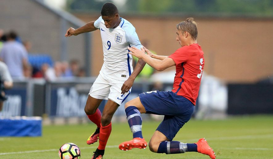 England's Marcus Rashford, left, and Norway's Ulrik Jenssen battle for the ball during the Under 21 Euro 2017 qualifying soccer match at the Community Stadium, Colchester, England, Tuesday Sept. 6, 2016. (Nigel French/PA via AP)