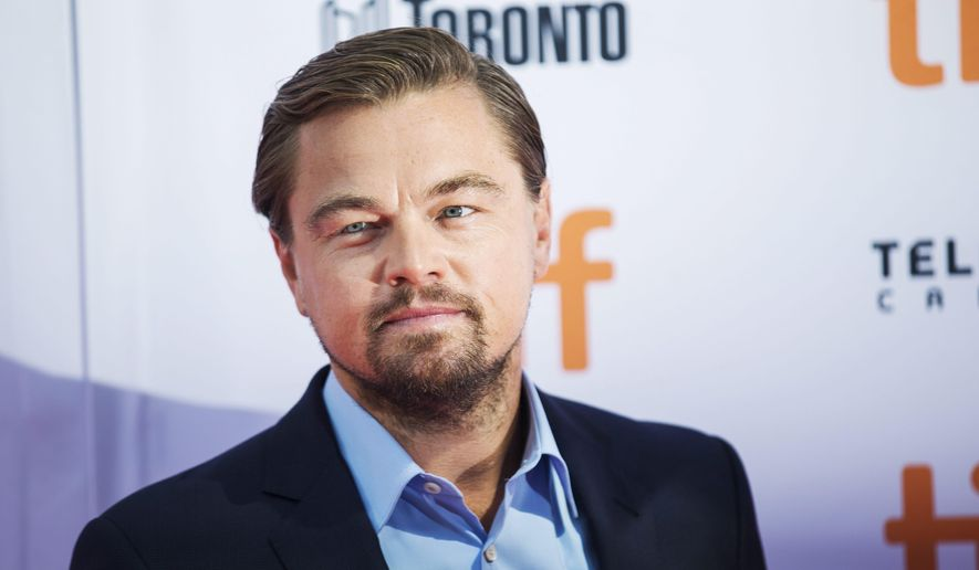 "Actor Leonardo DiCaprio arrives on the red carpet to promote the film ""Before The Flood"" during the Toronto International Film Festival on Friday, Sept. 9, 2016. (Michelle Siu/The Canadian Press via AP)"