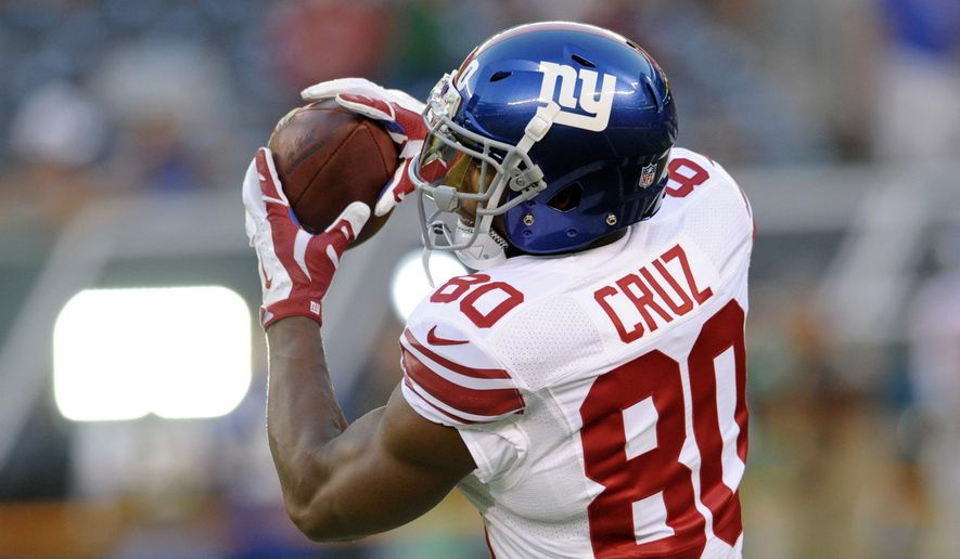 FILE - In this Aug. 27, 2016, file photo, New York Giants wide receiver Victor Cruz (80) catches a pass before an NFL preseason football game against the New York Jets in East Rutherford, N.J. Cruz is expected to play in his first game on Sunday against the Dallas Cowboys, since the middle of the 2014 season, when he injured a knee.  (AP Photo/Bill Kostroun) ** FILE **