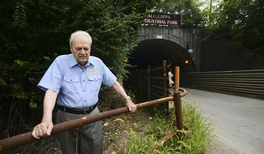 ADVANCE FOR RELEASE SATURDAY, SEPTEMBER 10, 2016, AT 3:01 A.M. EDT. AND THEREAFTER - In this Aug. 31, 2016, photo, Gino Piroli stands in front of the tunnel which leads to the Aliquippa Industrial Park, which used to be the entrance to the former J & L property in Aliquippa, Pa. Workers' rights might not even exist today if it weren't for a U.S. Supreme Court case that unfolded in Aliquippa in 1937. To Piroli, the 1937 Supreme Court decision was more than just a blurb in history books. (Lucy Schaly/Beaver County Times via AP)