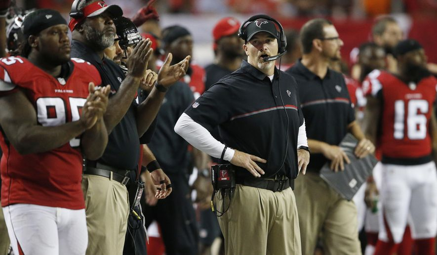 FILE - In this Sept. 1, 2016, file photo, Atlanta Falcons head coach Dan Quinn watches play against the Jacksonville Jaguars during the first half of a preseason NFL football game in Atlanta. Quinn says his team has grown closer since the front office redesigned the locker room during the offseason and changed locker locations so players are no longer grouped by position. (AP Photo/John Bazemore, File)