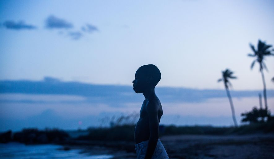 "This image released by A24 Films shows Alex Hibbert in a scene from the film, ""Moonlight.""  The film is  a poetic coming-of-age tale told across three chapters about a young gay black kid growing up in a poor, drug-ridden neighborhood of Miami. (David Bornfriend/A24 via AP)"
