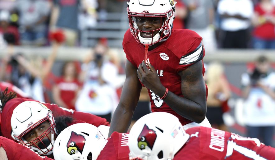 FILE - In this Sept. 1, 2016, file photo, Louisville quarterback Lamar Jackson calls out at the line of scrimmage during the team's NCAA college football game against Charlotte in Louisville, Ky. Jackson gets a Friday night spotlight game after accounting for eight touchdowns last week against Charlotte. Eight! In a season with lots of big stars, Jackson is a B-list Heisman contender for now. The next two weeks could get his name on the marquee. (AP Photo/Timothy D. Easley, File)