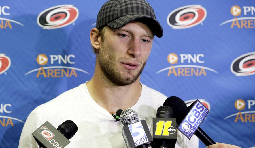 Carolina Hurricanes' Jordan Staal speaks with the media during the NHL hockey team's media day in Raleigh, N.C., Friday, Sept. 9, 2016. (AP Photo/Gerry Broome)