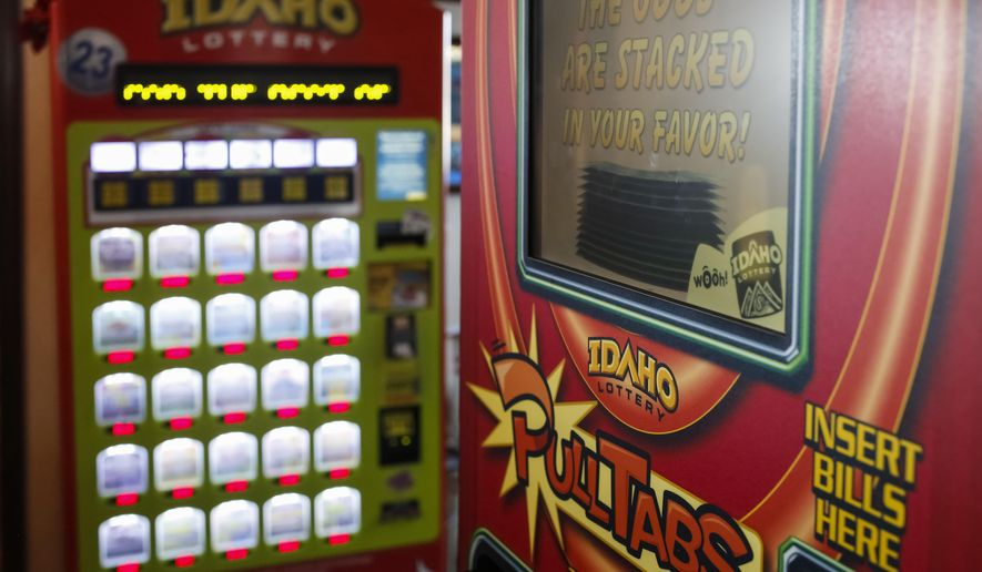 FILE--This file photo taken March 5, 2015, shows an Idaho Lottery scratch ticket vending machine, left, and an Idaho Lottery PullTabs machine at Westy's Garden Lanes in Garden City, Idaho. Idaho State Lottery officials are asking potential vendors to provide information on how they would offer Keno, simulated racing, fantasy sports and other illegal gambling games when they bid on a lucrative decade-long contract--gambling companies hoping to be the next Idaho State Lottery provider have until the end of Friday, Sept. 9, 2016, to turn in their bids. (AP Photo/Otto Kitsinger)