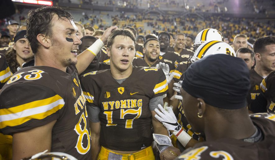 Wyoming quarterback Josh Allen, center, stands with his teammates after an NCAA college football game against Northern Illinois Saturday, Sept. 4, 2016 at the War Memorial Stadium in Laramie, Wyo.  (Hugh Carey/The Wyoming Tribune Eagle via AP)