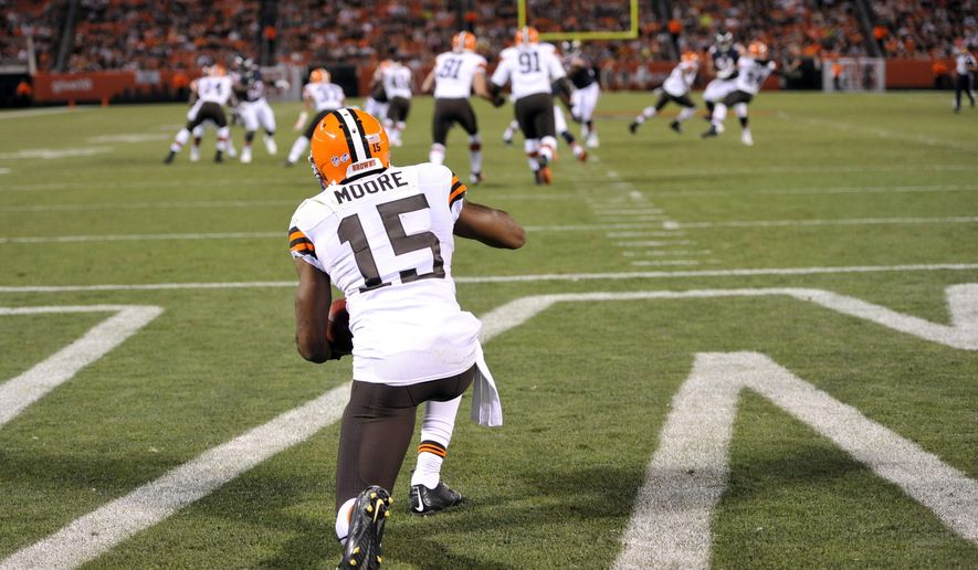 FILE - In this Aug. 28, 2014, file photo, Cleveland Browns' Marlon Moore (15) takes a knee for a touchback in the second quarter of a preseason NFL football game against the Chicago Bears in Cleveland. Exhibition games serve a purpose for people such as officiating chief Dean Blandino and head of football operations Troy Vincent. The information gathering includes looking at kickoffs, how technology is used, officiating, and, yes, the length of the preseason. The theory on having touchbacks move 5 more yards to the 25 is it will reduce the number of returns in what is considered one of the most dangerous (yet entertaining) plays in the sport. (AP Photo/David Richard, File)