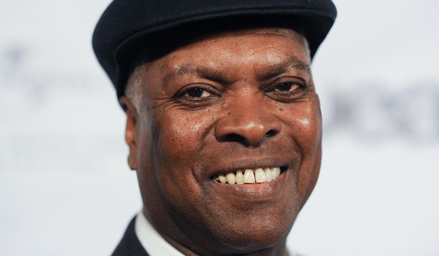 FILE - In this May 9, 2013 file photo, Booker T. Jones arrives at the NARM Music Biz 2013 Dinner Party in Century City, Calif. Booker will perform at the Halloran Center in Memphis on Saturday, Sept. 10. (Photo by Richard Shotwell/Invision/AP, File)