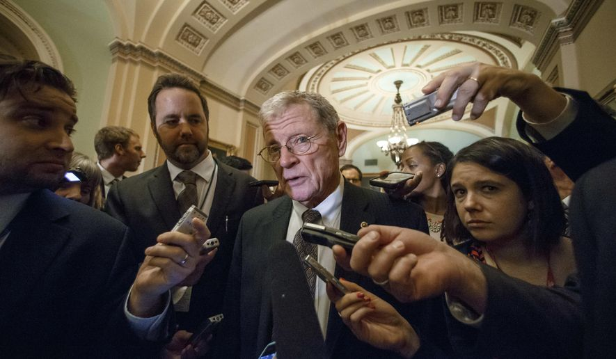 Sen. James Inhofe, Oklahoma Republican, is surrounded by reporters on Capitol Hill in Washington on Jan. 7, 2015. (Associated Press) **FILE**
