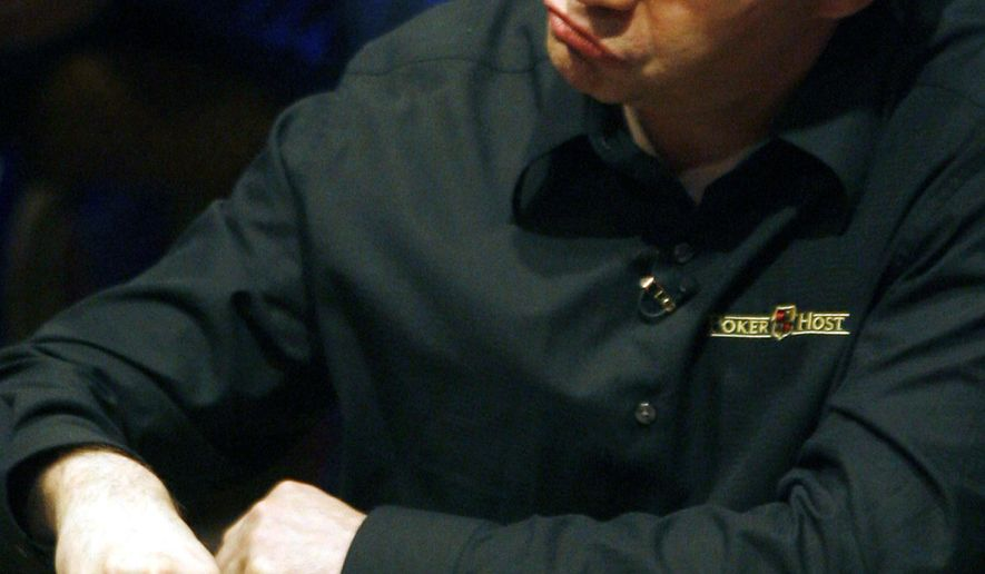 FILE - This March 6, 2006 file photo shows Ted Forrest mulls over a play during the National Heads-Up Poker championship finals at Caesars Palace in Las Vegas. Forrest who has won millions of dollars in tournaments is fighting felony theft and bad check charges in Las Vegas, where a casino accuses him of failing to repay $215,000 in gambling debts. (AP Photo/Isaac Brekken,File)