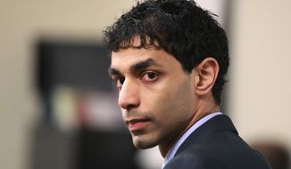 FILE – In this March 2, 2012, file photo, Dharun Ravi waits for his trial to begin at the Middlesex County Courthouse in New Brunswick, N.J. In a Friday, Sept. 9, 2016, ruling, a New Jersey appeals court threw out the 15-count conviction of the former Rutgers University student, whose roommate Tyler Clementi killed himself in 2010 after being captured on a webcam kissing another man. (John Munson/The Star-Ledger via AP, Pool, File)