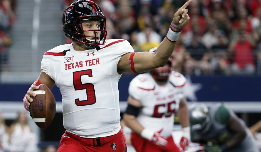 FILE - In this Oct. 3, 2015, file photo, Texas Tech quarterback Patrick Mahomes prepares to pass against Baylor during an NCAA college football game in Arlington, Texas. Arizona State hosts Texas Tech on Saturday.  (AP Photo/Tony Gutierrez, FIle)
