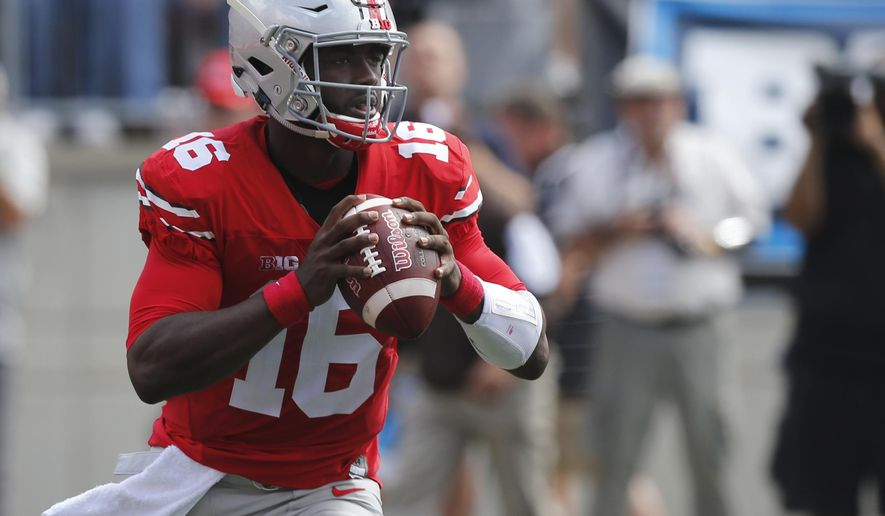 FILE - In this Sept. 3, 2016, file photo, Ohio State quarterback J.T. Barrett plays against Bowling Green during an NCAA college football game, in Columbus, Ohio. Tulsa will be a huge underdog at no. 4 Ohio State on Saturday. (AP Photo/Jay LaPrete, File)