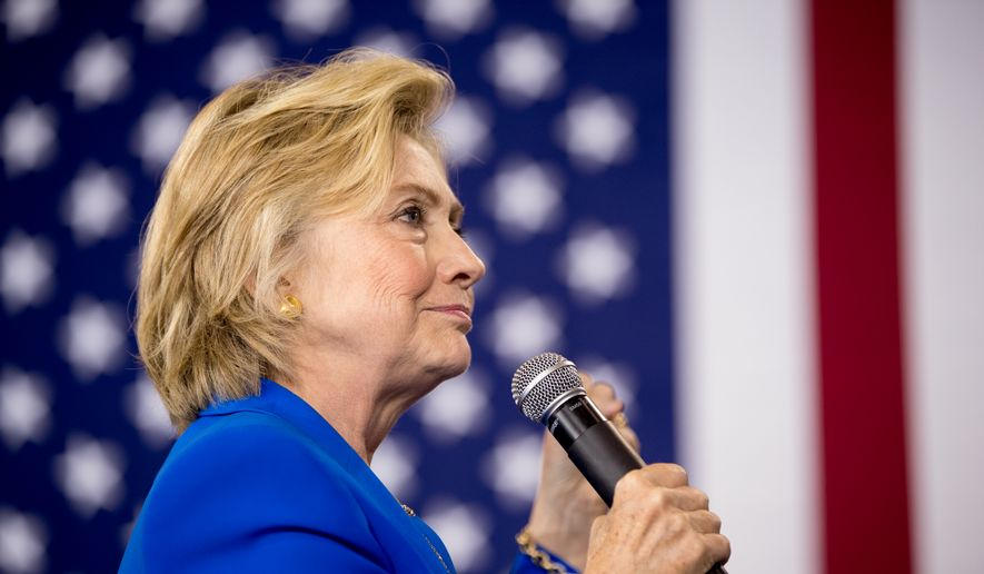 Democratic presidential candidate Hillary Clinton pauses while speaking at a rally at Johnson C. Smith University, in Charlotte, N.C., Thursday, Sept. 8, 2016. (AP Photo/Andrew Harnik)