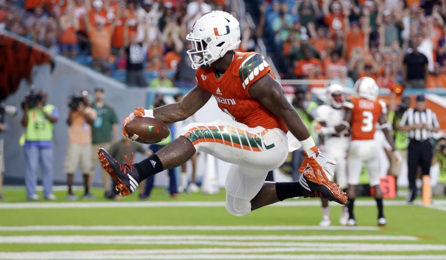 Miami running back Mark Walton (1) scores a touchdown against Florida Atlantic during the first half of an NCAA college football game Saturday, Sept. 10, 2016, in Miami Gardens, Fla. (AP Photo/Alan Diaz)