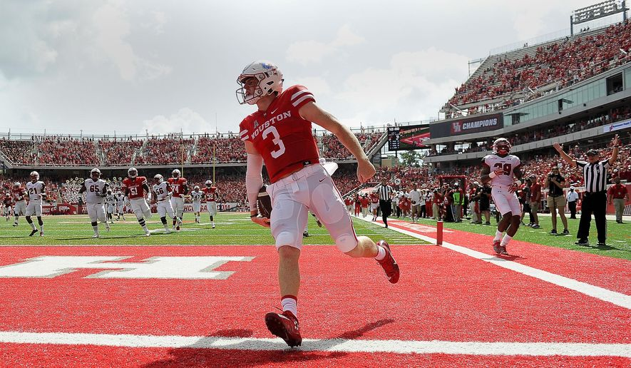 Houston quarterback Kyle Postma (3) scores a touchdown on a 39-yard run in the first half of an NCAA college football game against Lamar, Saturday, Sept. 10, 2016, in Houston. (AP Photo/Eric Christian Smith)