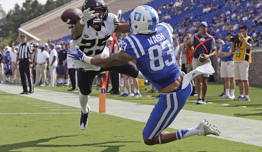 Duke's Anthony Nash (83) reaches for a pass as Wake Forest's Brad Watson (25) defends during the first half of an NCAA college football game in Durham, N.C., Saturday, Sept. 10, 2016. Watson was called or pass interference on the play. (AP Photo/Gerry Broome)