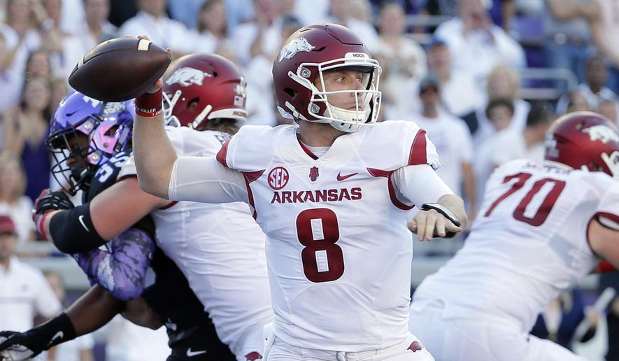 Arkansas quarterback Austin Allen (8) throws a pass in the first half of an NCAA college football game against TCU on Saturday, Sept. 10, 2016, in Fort Worth, Texas. (AP Photo/Tony Gutierrez)