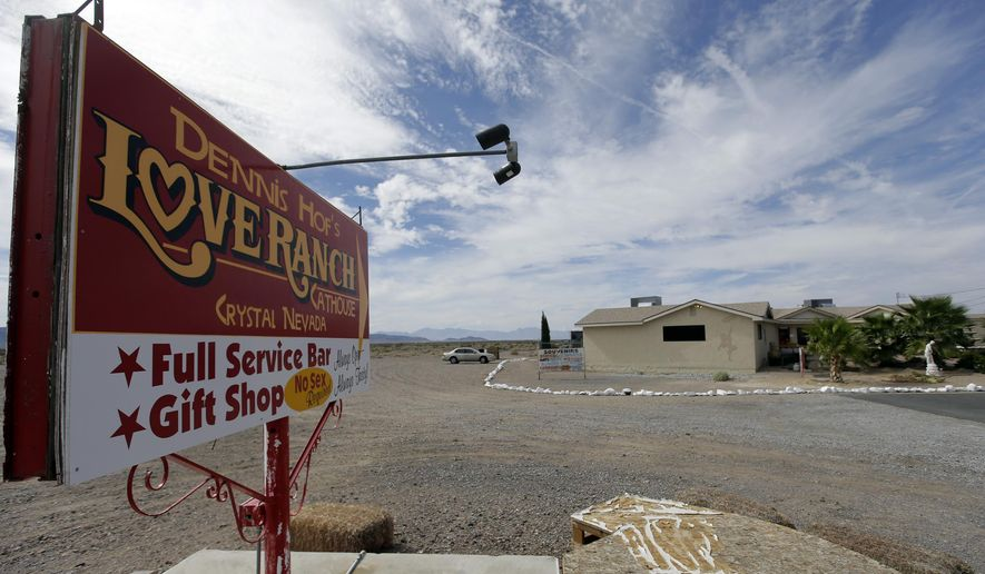 FILE - In this Oct. 14, 2015, file photo, a sign advertises the Love Ranch brothel in Crystal, Nev. The cost of brothel licensing is up for debate in Nye County. Changes to the quarterly brothel licensing fees would be the first updates in more than two decades. (AP Photo/Chris Carlson, File)
