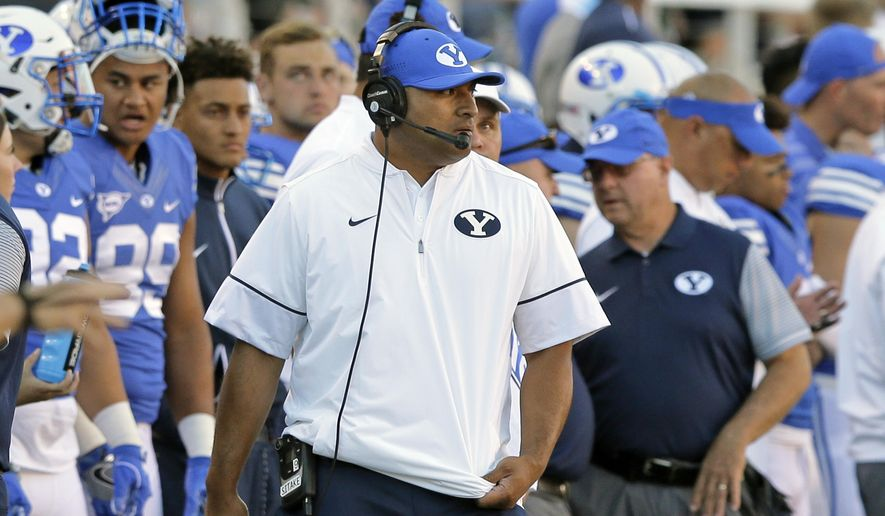 BYU head coach Kalani Sitake, center, looks on during the first half of an NCAA college football game against Utah, Saturday, Sept. 10, 2016, in Salt Lake City. (AP Photo/Rick Bowmer)
