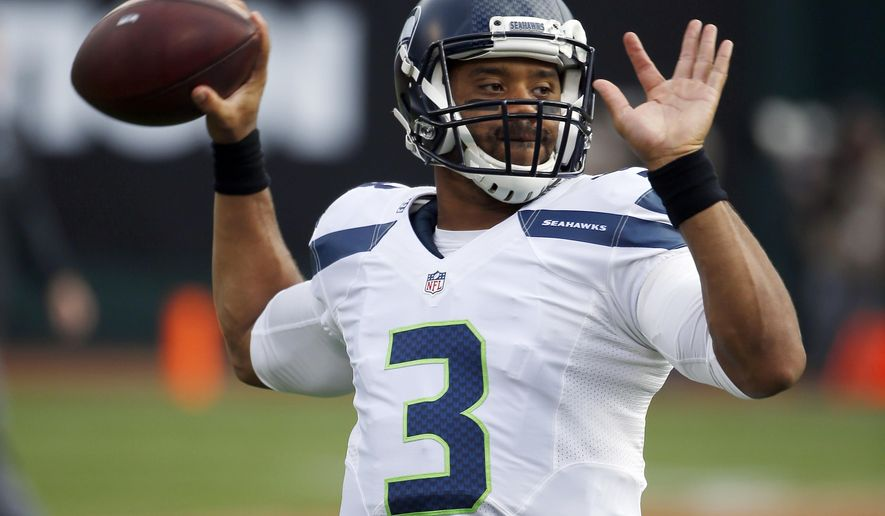 FILE - In this Sept. 1, 2016 file photo, Seattle Seahawks quarterback Russell Wilson (3) warms up before a preseason NFL football game against the Oakland Raiders in Oakland, Calif. The Seahawks play the Miami Dolphins Sunday, Sept. 11 with the offense in the hands of Wilson, coming off the finest season of his young career. (AP Photo/Tony Avelar, File)