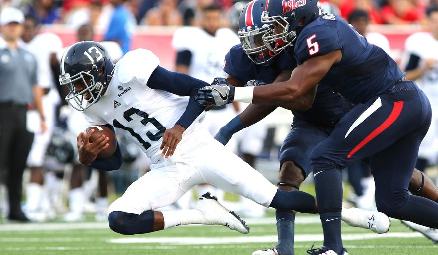 Georgia Southern quarterback Favian Upshaw (13) dives for yardage against South Alabama safety Kalen Jackson and linebacker Roman Buchanan (5) during the first half of an NCAA football game Saturday, Sept. 10, 2016, in Mobile, Ala. (Mike Kittrell/AL.com via AP)