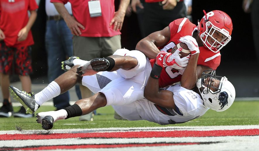 Rutgers wide receiver Andre Patton (88) catches a pass for a touchdown as Howard defensive back Yoseff Banks (29) tries to defend during the first half of an NCAA college football game Saturday, Sept. 10, 2016, in Piscataway, N.J. (AP Photo/Mel Evans)