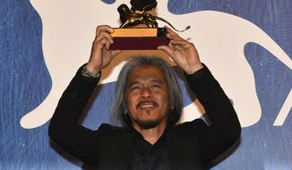 """Filipino film maker Lav Diaz holds the Golden Lion award for his movie """" Ang Babaeng Humayo """" (The woman who left) during the awards ceremony of the 73rd Venice International Film Festival, in Venice, Italy, Saturday, Sept. 10, 2016. (M. Angeles Salvador/ANSA via AP)"""