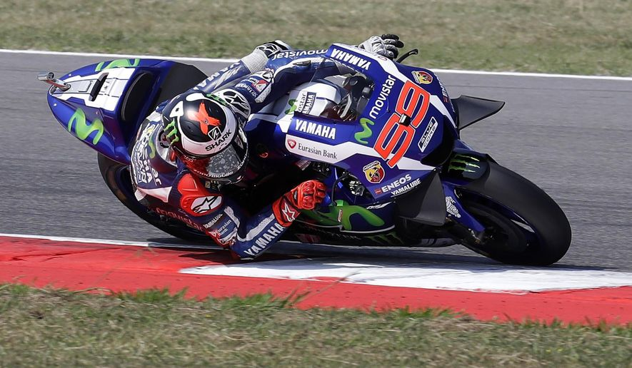 Spain's rider Jorge Lorenzo steers his Yamaha during the fourth practice session for Sunday's San Marino Moto GP race, at the Misano circuit, in Misano Adriatico, Italy, Saturday, Sept. 10, 2016. (AP Photo/Antonio Calanni)